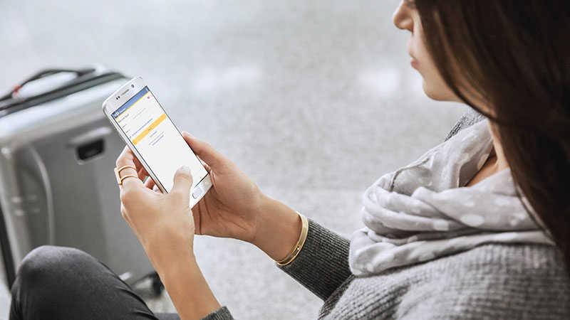 woman shopping on mobile using visa checkout