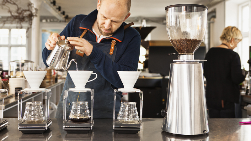 Man using an espresso machine