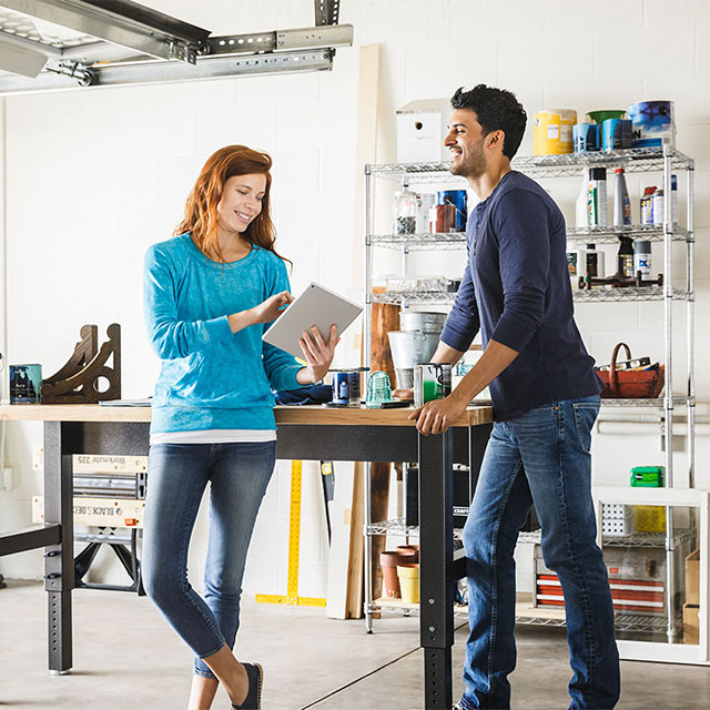 man and woman looking at tablet computer