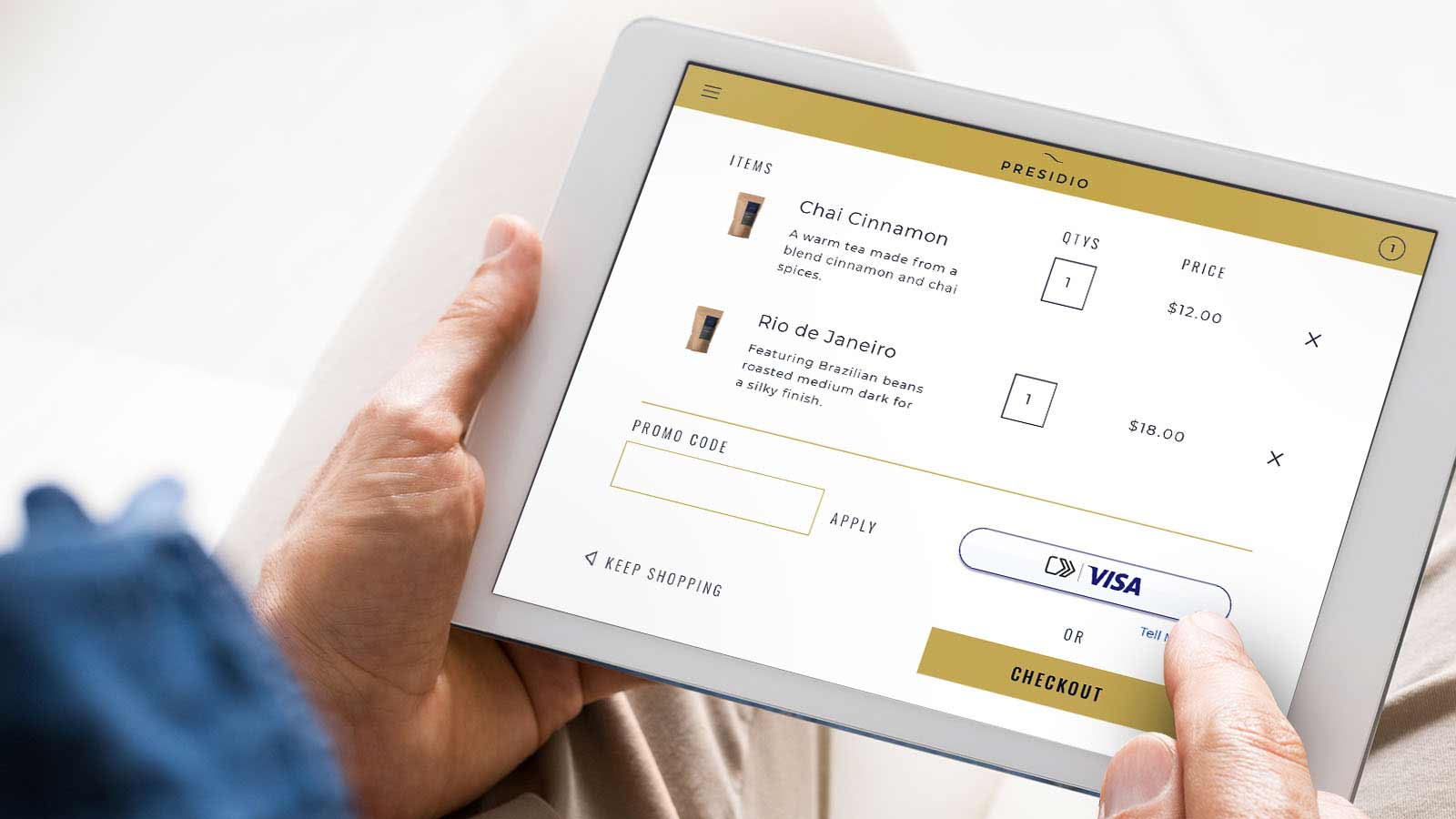Closeup of a tablet displaying the new Visa checkout experience.